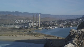 DFKSF03_003 - 5K stock footage aerial video of flyby Morro Rock, reveal Dynegy Power Plant and smoke stacks, Morro Bay, California