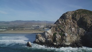 DFKSF03_004 - 5K stock footage aerial video of the Dynegy Power Plant and smoke stacks, reveal Morro Rock, Morro Bay, California
