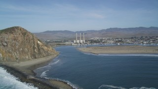 DFKSF03_006 - 5K stock footage aerial video of a view of Morro Rock and the Dynegy Power Plant with smoke stacks, Morro Bay, California