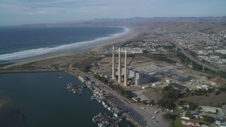 DFKSF03_008 - 5K stock footage aerial video of flying by the coastal Dynegy Power Plant with smoke stacks, Morro Bay, California