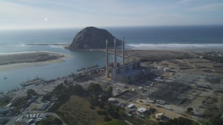 DFKSF03_009 - 5K stock footage aerial video of the Dynegy Power Plant with smoke stacks, reveal Morro Rock, Morro Bay, California