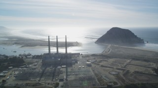DFKSF03_010 - 5K stock footage aerial video of flying by Dynegy Power Plant and Morro Rock in Morro Bay, California