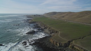 DFKSF03_014 - 5K stock footage aerial video of following the coastline near Highway 1, Estero Bay, California