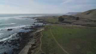 DFKSF03_015 - 5K stock footage aerial video of following the rugged coastline, Estero Bay, California