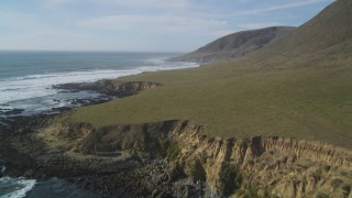 DFKSF03_024 - 5K stock footage aerial video of flying over the green coastline, Harmony, California