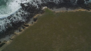 DFKSF03_039 - 5K stock footage aerial video of a bird's eye view of the rocky coastline and coastal cliffs, Cambria, California
