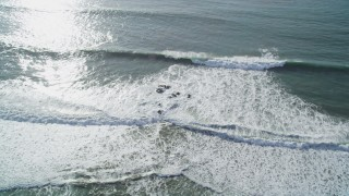 DFKSF03_047 - 5K stock footage aerial video of flying by ocean waves, Cambria, California