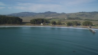DFKSF03_057 - 5K aerial stock footage video of panning across San Simeon Bay, revealing San Simeon, California