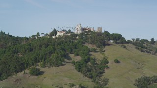DFKSF03_062 - 5K stock footage aerial video of approaching historic Hearst Castle, San Simeon, California