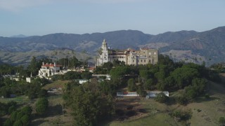 DFKSF03_063 - 5K stock footage aerial video of flying by Hearst Castle, San Simeon, California