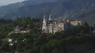 DFKSF03_064 - 5K stock footage aerial video of flying by the east side of iconic Hearst Castle, San Simeon, California