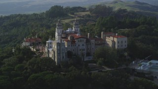 DFKSF03_065 - 5K stock footage aerial video of flying by the east side of Hearst Castle, San Simeon, California