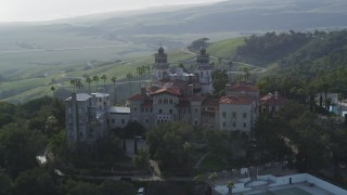 DFKSF03_066 - 5K stock footage aerial video of flying by the east and north side of historic Hearst Castle, San Simeon, California