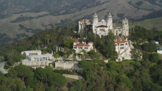 DFKSF03_069 - 5K stock footage aerial video of flying away from Hearst Castle, San Simeon, California