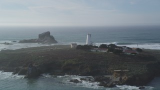 DFKSF03_072 - 5K stock footage aerial video approach and flyby Point Piedras Blancas lighthouse, San Simeon, California