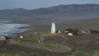 DFKSF03_073 - 5K stock footage aerial video of flying by Point Piedras Blancas lighthouse, San Simeon, California
