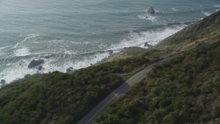 DFKSF03_086 - 5K stock footage aerial video of flying by Highway 1 coastal road above cliffs, Big Sur, California