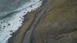 DFKSF03_091 - 5K stock footage aerial video of tracking a car traveling on Highway 1 along the coast, Big Sur, California