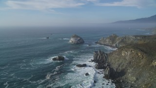 DFKSF03_093 - 5K stock footage aerial video of an approach to a large rock formation off the coast, Big Sur, California