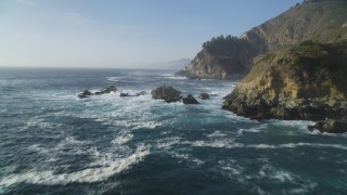 DFKSF03_120 - 5K stock footage aerial video of flying by coastal cliffs and over rock formations, Big Sur, California