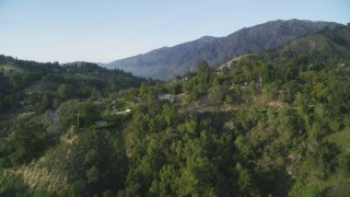 DFKSF03_130 - 5K stock footage aerial video of approaching Highway 1, revealing Ventana Inn & Spa hotel, Big Sur, California