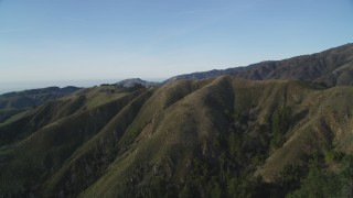 DFKSF03_133 - 5K stock footage aerial video of flying over ridges in mountain landscape, Los Padres National Forest, California