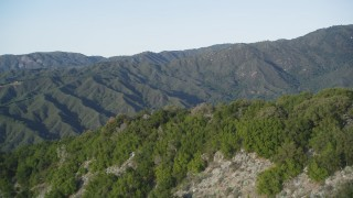 DFKSF03_137 - 5K stock footage aerial video pan across green ridges in a mountain landscape, Los Padres National Forest, California