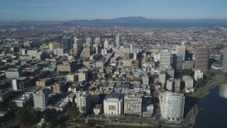 DFKSF05_002 - 5K stock footage aerial video approach and pan across city buildings in Downtown Oakland, California