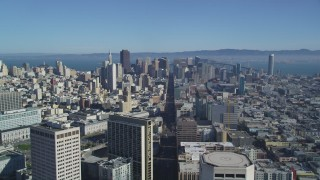 DFKSF05_016 - 5K stock footage aerial video of following Market Street to approach skyscrapers in Downtown San Francisco, California