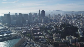 DFKSF05_023 - 5K stock footage aerial video of skyscrapers and Coit Tower in North Beach, Downtown San Francisco, California