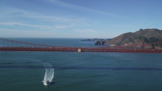 DFKSF05_036 - 5K stock footage aerial video of flying over the iconic Golden Gate Bridge toward the Marin Headlands, San Francisco, California