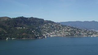 DFKSF05_044 - 5K stock footage aerial video flyby the Marin Hills revealing the coastal community of Sausalito, California