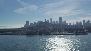 DFKSF05_073 - 5K stock footage aerial video approach iconic Pier 39, Coit Tower, views of skyline, Downtown San Francisco, California
