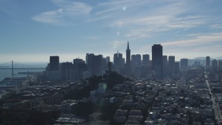 DFKSF05_074 - 5K stock footage aerial video approach iconic Coit Tower and city's skyline, Downtown San Francisco, California