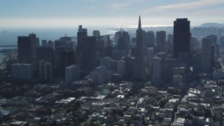 DFKSF05_075 - 5K stock footage aerial video fly over Coit Tower, approach Transamerica Pyramid and skyline, Downtown San Francisco, California