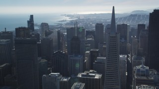 DFKSF05_076 - 5K stock footage aerial video of approaching iconic Transamerica Pyramid and skyscrapers, Downtown San Francisco, California
