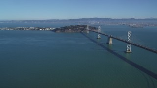DFKSF05_086 - 5K stock footage aerial video of a view of the Bay Bridge, Yerba Buena Island, Treasure Island in San Francisco, California