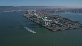 DFKSF05_092 - 5K stock footage aerial video approach large cargo cranes at the Port of Oakland, California