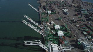 DFKSF05_093 - 5K stock footage aerial video of flying over four cargo cranes at the Port of Oakland, California
