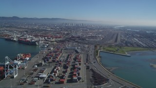 DFKSF05_094 - 5K stock footage aerial video of panning across shipping containers and flying over the Port of Oakland, California