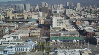 DFKSF05_095 - 5K stock footage aerial video of flying by Jack London Square and office buildings, Oakland, California