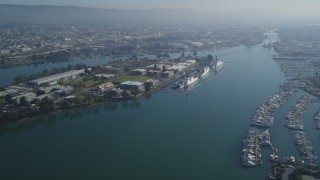 DFKSF05_096 - 5K stock footage aerial video of flying by Coast Guard Island, Oakland, California