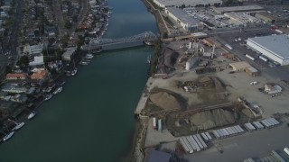 DFKSF06_002 - 5K stock footage aerial video of flying over Oakland Estuary to approach High Street Bridge, Oakland, California