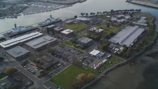 DFKSF06_006 - 5K stock footage aerial video of tilting up from Union Point Park to reveal Coast Guard Island base, Oakland, California
