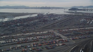 DFKSF06_013 - 5K stock footage aerial video tilt from I-880 freeway, revealing the Port of Oakland, California