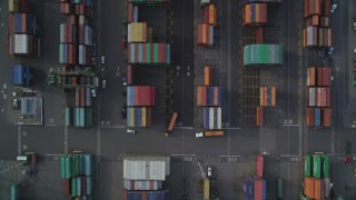 DFKSF06_015 - 5K stock footage aerial video of bird's eye view of Port of Oakland shipping containers, California