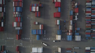 DFKSF06_017 - 5K stock footage aerial video of a bird's eye view of Port of Oakland shipping containers, California
