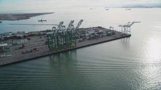 DFKSF06_020 - 5K stock footage aerial video of orbiting the cargo cranes and shipping containers at the Port of Oakland, California
