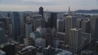 DFKSF06_027 - 5K stock footage aerial video of approaching the city's tall skyscrapers, Downtown San Francisco