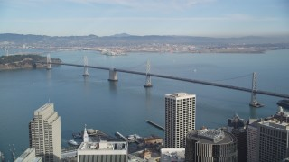 DFKSF06_046 - 5K stock footage aerial video of flying from downtown, approaching the Bay Bridge, San Francisco, California